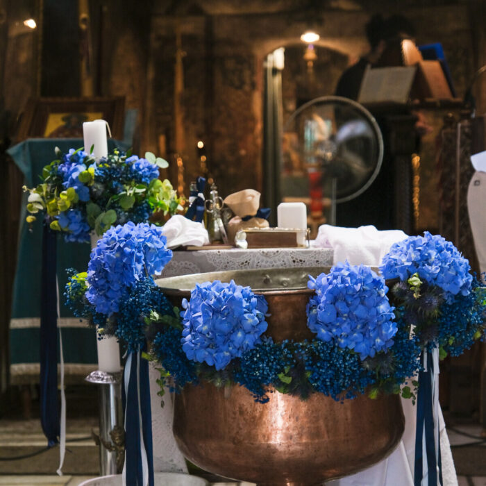 Baptistery Decoration for a Baptism in Greece for a boy with garland of blue hydrangeas and blue gypsophila.